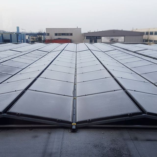 The back view of our new office.. #solarpanels #freakingcold